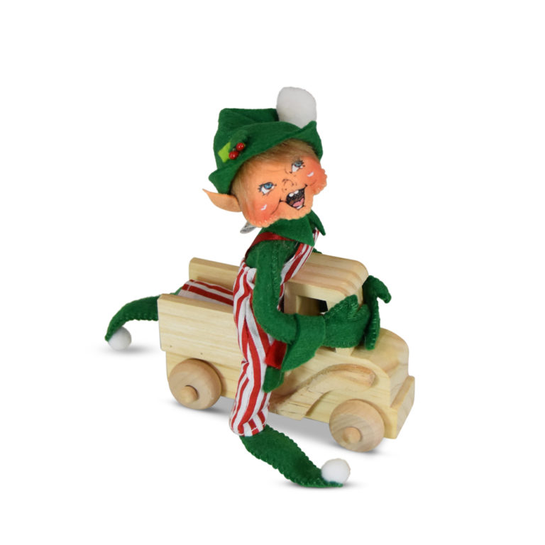 green christmas elf riding toy truck